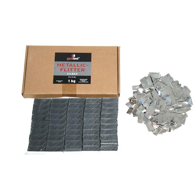 Metallic Flitter - Silber 1kg (Pappschachtel) F�r professionelle Konfetti-Kanonen im In- und Outdoorbereich. Eignet sich hervorragend zur Dekoration und kann bei Feierlichkeiten auch sehr gut geworfen werden. Mit aufregendem Metallic-Effekt. Schwer entflammbar gem. DIN 4102-1/B1 Zertifikat: B1 Gr��e: 50 x 20 mm Inhalt: 1 Kg Verpackung: Pappschachtel Material: Metallic-Folie