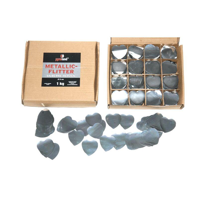 Metallic Flitter - Silberne Herzen 1kg (Pappschachtel) Für professionelle Konfetti-Kanonen im In- und Outdoorbereich. Eignet sich hervorragend zur Dekoration und kann bei Feierlichkeiten auch sehr gut geworfen werden. Mit aufregendem Metallic-Effekt. Schwer entflammbar gem. DIN 4102-1/B1 Zertifikat: B1 Größe: Ø50mm Inhalt: 1 Kg Verpackung: Pappschachtel Material: Metallic-Folie